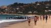 O barcă cu migranți a acostat pe o plajă cu turiști în Spania. Numărul lor este de de trei ori mai mare decât în anul trecut