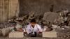O fetița siriană, care se visează campioană la karate, se antrenează printre ruinele din Alep