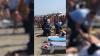 Scandalagii încătuşaţi pe o plajă aglomerată. Opt indivizi au fost puşi la pământ de către poliţie