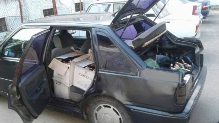 300 de sticle de coniac fără acte de proveniență, confiscate de polițiștii din Florești
