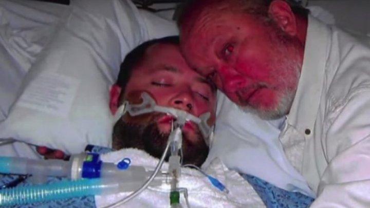Şi-a apărat fiul, aflat în moarte cerebrală, cu arma! Medicii doreau să-l deconecteze de la aparate