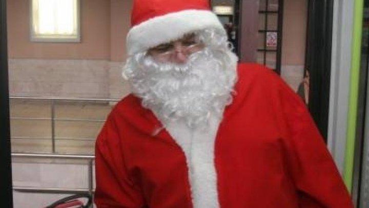Au dat lovitura fiind deghizaţi în Moş Crăciun! Doi români au făcut prăpăd într-un magazin din Italia