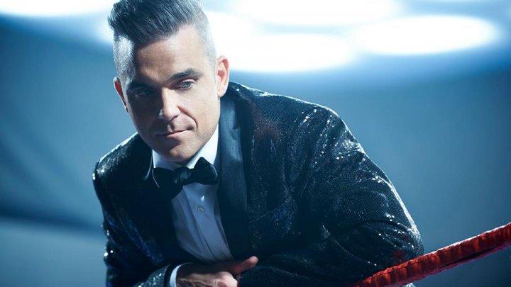 Robbie Williams va lansa un album de Crăciun alături de boxerul profesionist britanic Tyson Fury