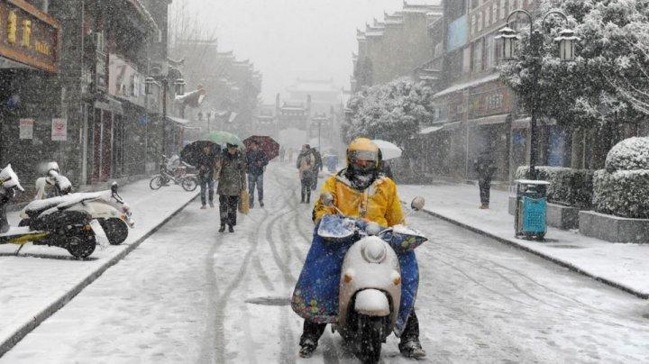 Ninsorile abundente din estul Chinei au provocat moartea a 13 persoane