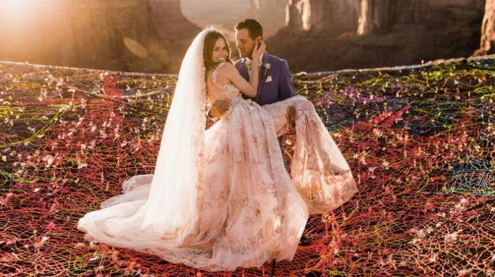 IMAGINI CARE-ŢI TAIE RESPIRAŢIA. Doi tineri s-au căsătorit pe o plasă, deasupra canionului (FOTO/VIDEO)