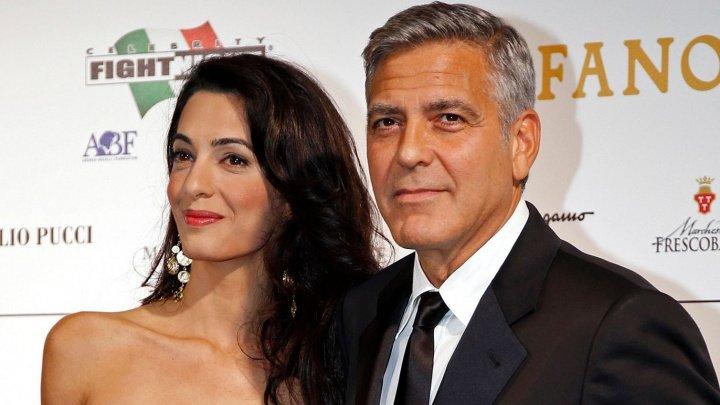 Soţii Clooney donează 500.000 de dolari pentru finanţarea unui protest