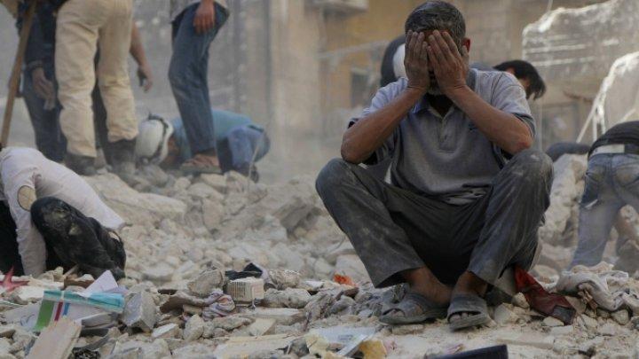 Masacru în Siria. Aproape 80 de civili au murit în bombardamente