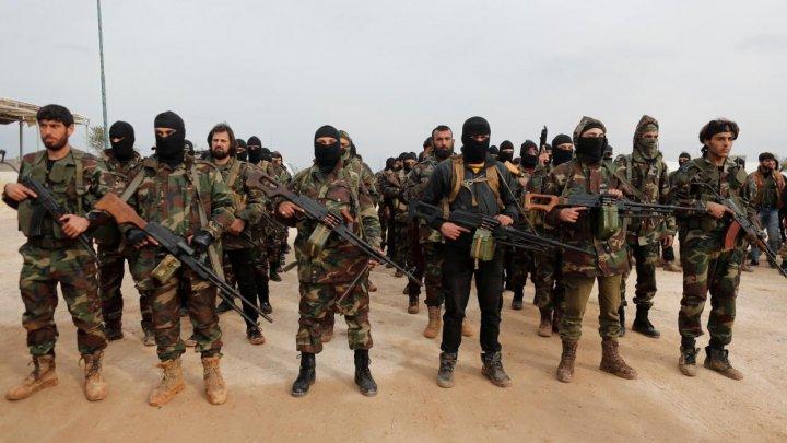 Două grupări ale insurgenţilor islamişti din nordul Siriei fuzionează