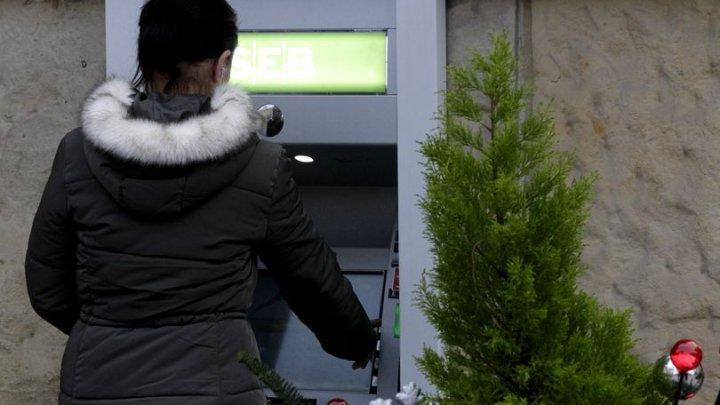 Șeful grupării care a furat 860.000 de euro într-o seară din bancomatele Raiffeisen Bank a fost arestat