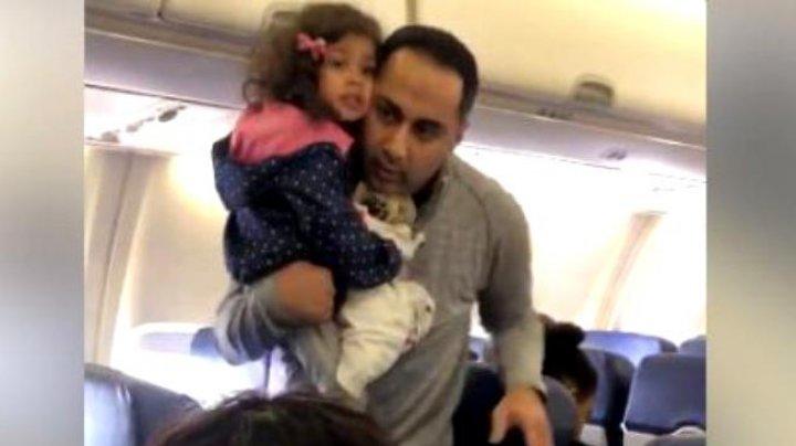 Un bărbat care zbura alături de fetița lui au fost impuşi să părăsească avionul pentru că micuței îi era frică de zbor (VIDEO)