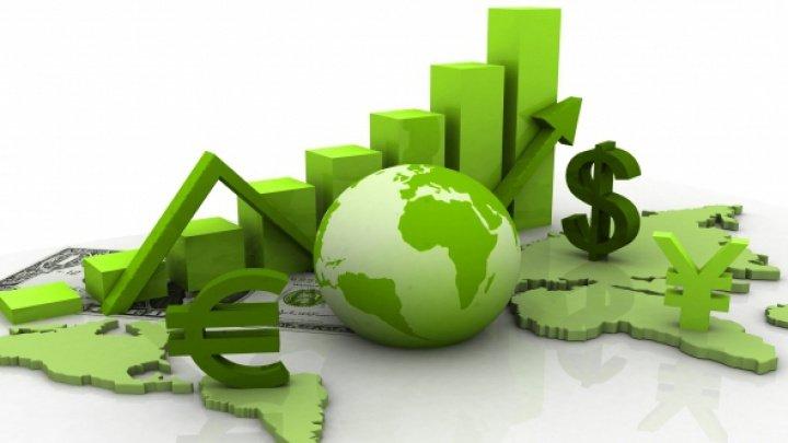 OECD şi-a îmbunătăţit estimările privind economia mondială, dar se teme de un război comercial