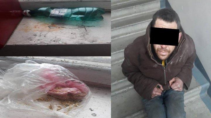 Un bărbat, PRINS în timp ce consuma droguri chiar în scara unui bloc din Capitală