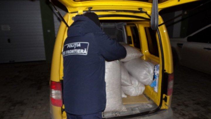 Business moldovenesc! O jumătate de tonă de miez de nucă, transportată ilegal de doi bărbați