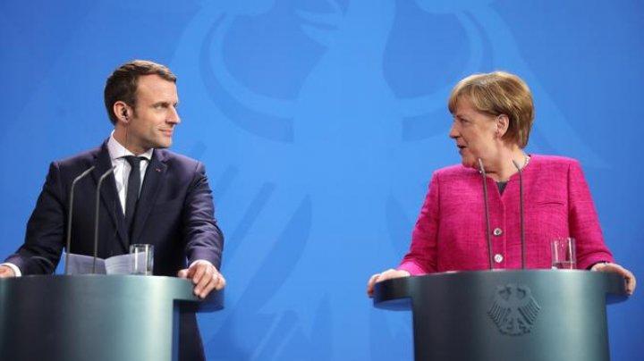 Angela Merkel şi Emmanuel Macron promit găsirea până în iunie a unui compromis franco-german privind reformarea UE