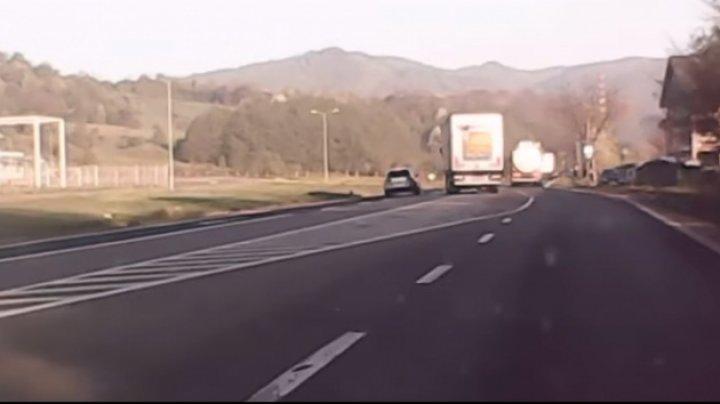 Scene incredibile în trafic! Un tir şi un SUV, la un pas de a se CIOCNI (VIDEO)