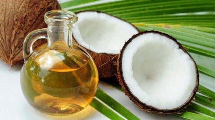 Studiu: Uleiul de cocos albește dantura şi înlătură durerea de cap