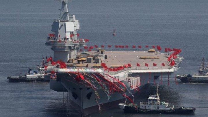 Cântăreşte 70.000 de tone şi deserveşte 36 de avioane Shenyang J-15. Primul portavion construit de chinezi a început testele pe mare