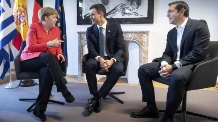 Berlinul va încheia un acord cu Atena şi cu Madridul privind migranţi