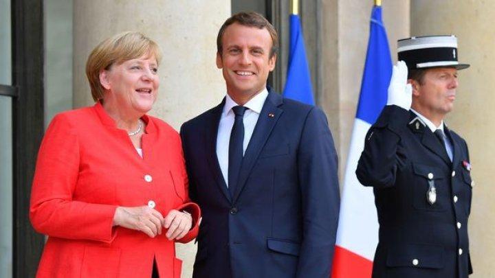 Merkel se întâlneşte cu Emmanuel Macron în plină criză a migranţilor, înaintea summitului UE