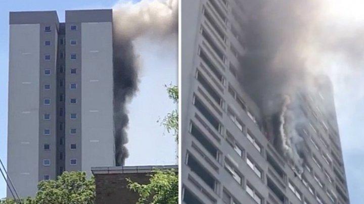 Un incendiu puternic a cuprins un bloc turn din estul Londrei. 58 de pompieri au intervenit