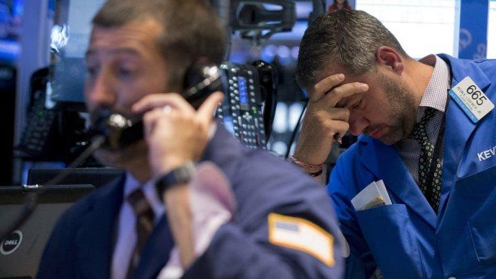 Câți bani au pierdut cei mai bogați oameni din lume în urma turbulenţelor de pe Wall Street