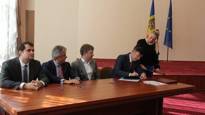 A fost semnat contractul care prevede cumpărarea a 41,09% din acțiunile MAIB