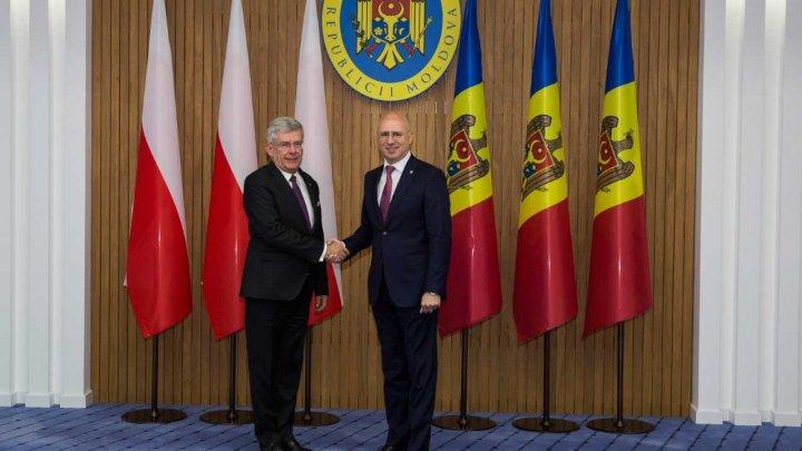 Pavel Filip, către președintele Senatului Poloniei: Apreciem susținerea în parcursul european, dar și asistența de dezvoltare oferită țării noastre