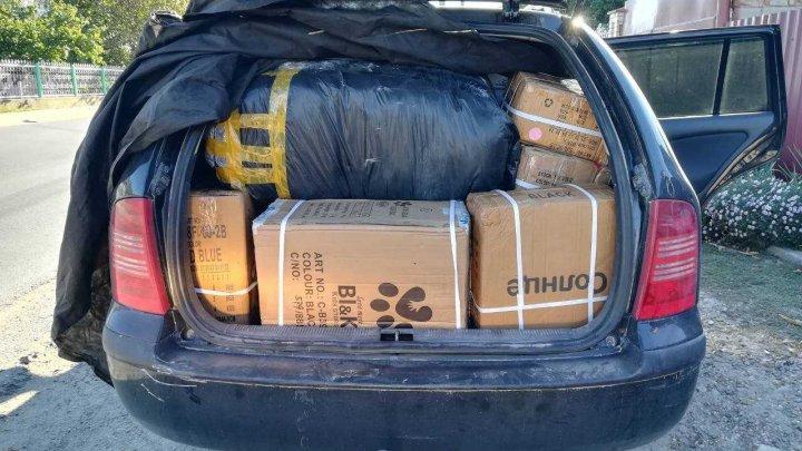 Marfă de contrabandă de circa 100.000 de lei, descoperită în maşina unui moldovean. De unde erau aduse bunurile
