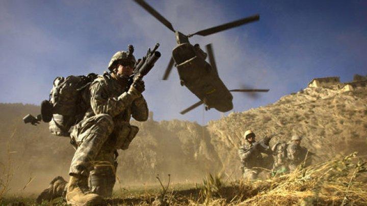 Atac în Afganistan: Un militar NATO a fost ucis, iar alţi doi răniţi