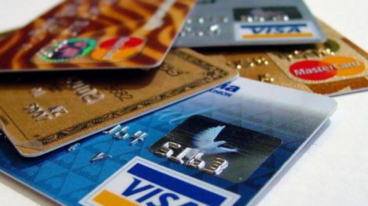 Visa şi Mastercard s-au oferit să reducă comisioanele pentru a scăpa de amenzi