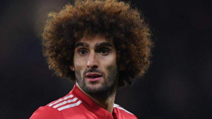 Mijlocaşul belgian al echipei Manchester United, Marouane Fellaini, a renunţat la frizura afro