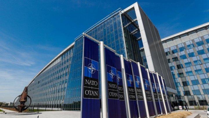 Întâlnire secretă între oficiali. Preşedintele României, cină la NATO cu Theresa May şi liderii Olandei şi Belgiei (VIDEO)