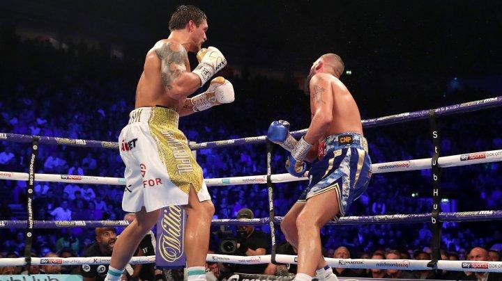 Ucraineanul Oleksandr Usik şi-a păstrat titlurile mondiale după ce l-a învins prin KO pe Tony Bellew