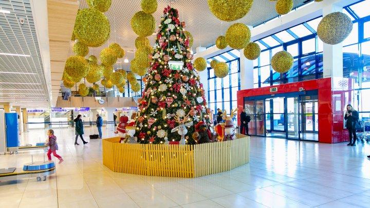 Atmosferă de basm pe Aeroportul Internaţional Chişinău. Ce surprize îi aşteaptă pe cei care vin acasă (FOTOREPORT)