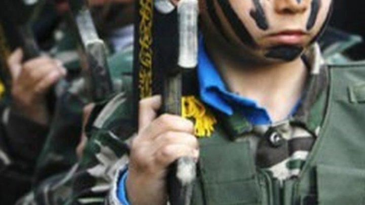 DATE ALARMANTE: Zeci de mii de copii sunt exploataţi ca soldaţi în conflicte armate în întreaga lume
