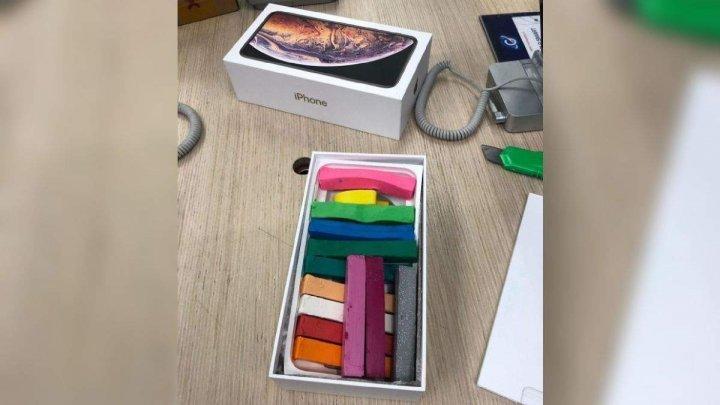 Hoții de iphone-uri care puneau plastilină în cutii, REŢINUŢI. Poliţia face DEZVĂLUIRI privind acest caz