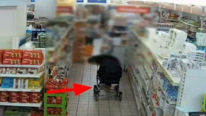 FĂRĂ PIC DE RUŞINE! Două femei s-au folosit de bebeluş pentru a fura conserve şi whisky din supermarket (VIDEO)