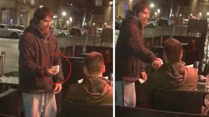 Imagini care te lasă fără cuvinte. Un tânăr, uimit de gestul unui om fără adăpost, după ce i-a dat cardul şi PIN-ul pentru a-şi scoate câţiva bani