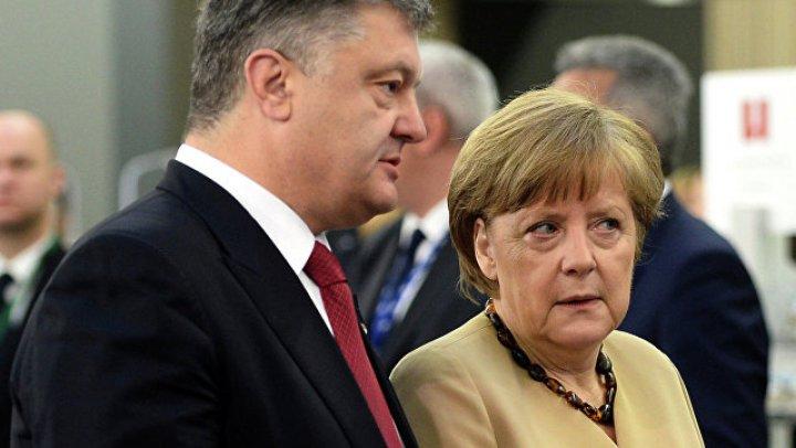 Angela Merkel susţine Ucraina şi cere continuarea dialogului cu Rusia