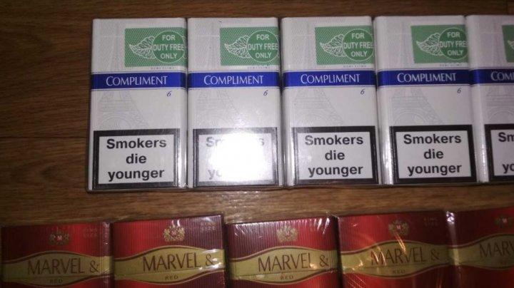 Percheziţii la domiciile a trei bărbaţi din Lipcani: Vindeau ţigări de CONTRABANDĂ din Ucraina în pieţile din localitate (FOTO)