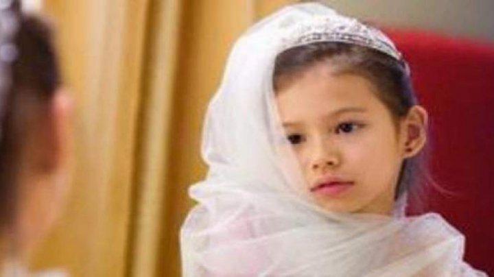 O copilă de 8 ani, măritată cu forța cu un bărbat de 40 de ani A MURIT în noaptea nunții. Ce îi facea mirele