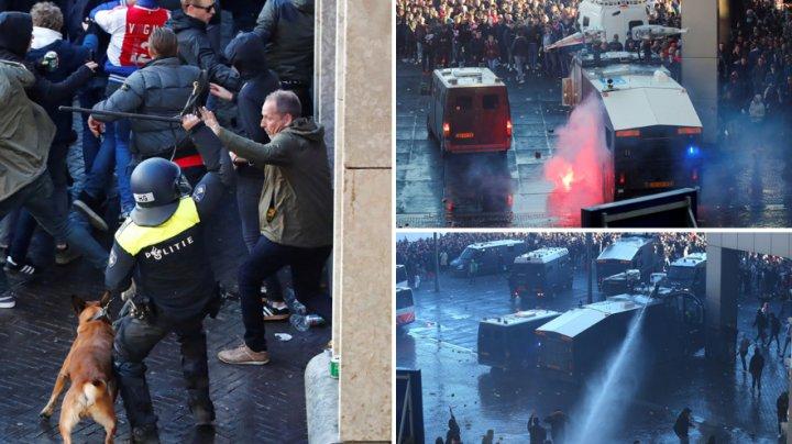 RĂFUIALĂ ÎNTRE ULTRAŞII AJAX ŞI JUVENTUS. Poliţia olandeză a avut mari bătăi de cap înainte de meci (GALERIE FOTO)
