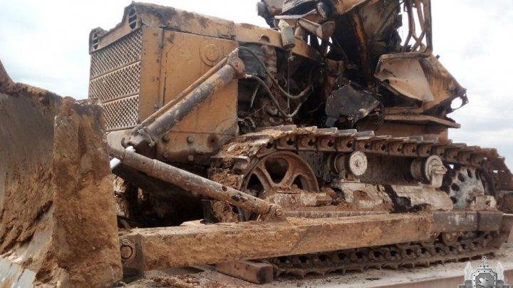 Un bărbat a căzut în gol cu buldozerul într-o carieră de pe teritoriul Combinatului de ciment din Rîbniţa (FOTO)
