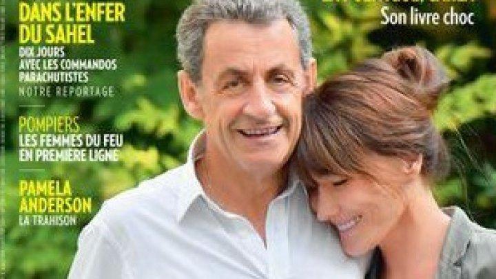 Sarcoky, mai înalt decât soția sa, pe o copertă de revistă. Fotografia, atacată ironic