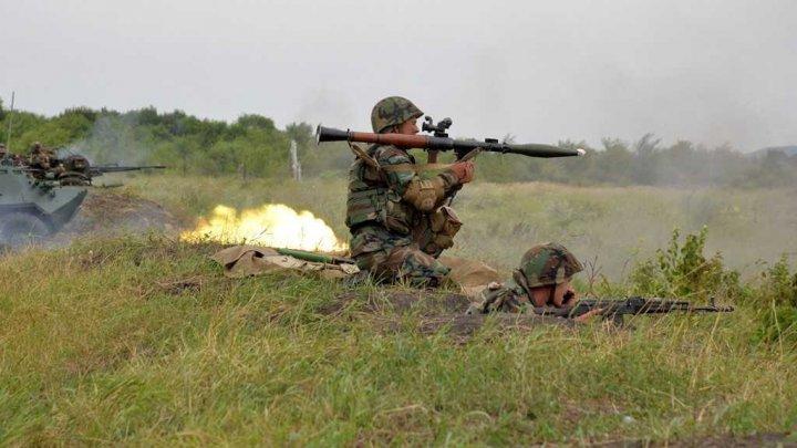 Peste 160 de militari din Brigada de infanterie motorizată Moldova şi Regimentul de Aviaţie Decebal au participat la exerciţiul tactic cu trageri de luptă
