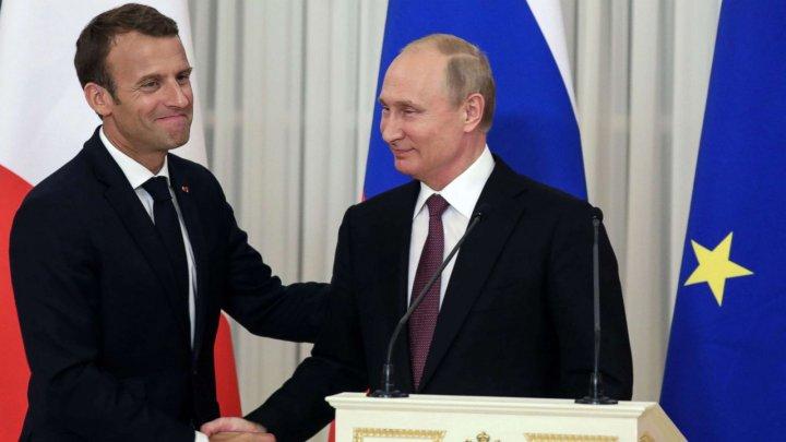 Vladimir Putin şi Emmanuel Macron vor să consolideze eforturile pentru salvarea acordului nuclear iranian