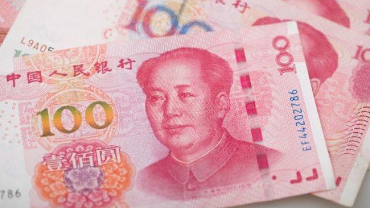 Yuanul s-a depreciat la cel mai redus nivel faţă de dolar din ultimii 11 ani
