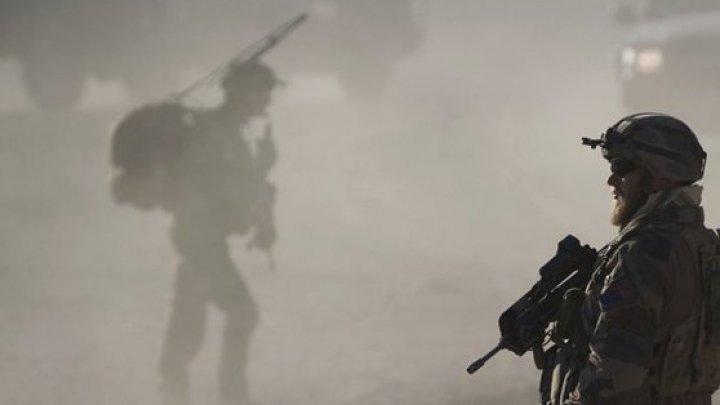 Irak: Un mort şi 29 de răniţi, în urma unei explozii la un depozit de armament