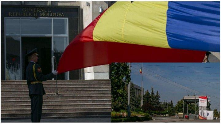 STOP CADRU! În timp ce Guvernul Sandu coboară drapelul în bernă, muncitorii lui Dodon instalează scena pentru concert (FOTOREPORT)