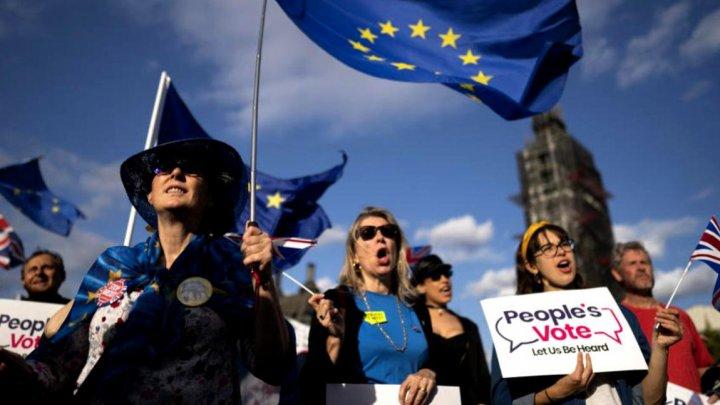 Marea Britanie renunță la planul de a anula libera circulație a imigranților UE după BREXIT